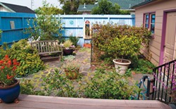 PHOTO BY CLAY JOHNSON - A backyard with recycled concrete paving stones.