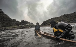 PHOTO BY JASON SELF - Johnson Padilla teaches Brooke Cena to roll a Greenland kayak on Trinidad Bay.