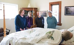 PHOTO BY MARK MCKENNA - Arcata Threshold Choir members (left to right) Lissa Anderson, Kate Green, Maggie McKnight and Jane Riggan demonstrate a bedside singing at Riggan's home.