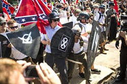 EZE AMOS - White nationalists clash with counter protesters in Charlottesville.