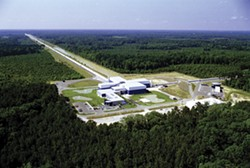 "PHOTO COURTESY OF CALTECH/MIT/LIGO LAB - The two 2.5-mile-long arms of the LIGO instruments (this one is in Louisiana) allow detection of gravitational ""ripples"" that cause miniscule changes in their lengths."