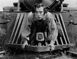 BY BUSTER KEATON - HTTP://WWW.ARCHIVE.ORG/DETAILS/THE_GENERAL_BUSTER_KEATON, PUBLIC DOMAIN, HTTPS://COMMONS.WIKIMEDIA.ORG/W/INDEX.PHP?CURID=17570271 - Buster Keaton rides the cowcatcher in The General