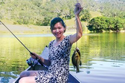 PHOTO BY KEVIN SMITH - Diane Tu with a pair of panfish.