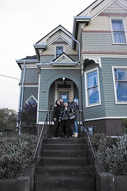 PHOTO BY LINDA STANSBERRY - Former tenants of Agape House gather on its front steps to say goodbye.