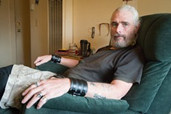PHOTO BY MARK MCKENNA - Don Brown in the apartment at 833 H St. that he's been ordered to vacate by 6 a.m. on Jan. 22.