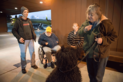 PHOTO BY MARK MCKENNA - Huck works with Nikki while his owners Pam and Jack Jones watch along with LCSW Deborah Reeves.