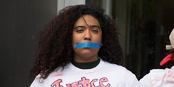 "THADEUS GREENSON - Some protesters wore tape over their mouths and T-shirts with ""Justice for Josiah"" scrawled across them."
