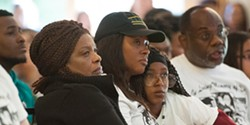 FILE PHOTO - Josiah Lawson's mother, Charmaine, and grandmother listen to a speaker at the 2017 memorial service.