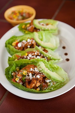 AMY KUMLER - Las Tazas chicken mole lettuce cups.