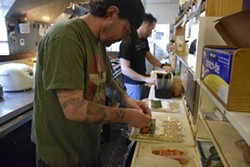 PHOTO BY JENNIFER FUMIKO CAHILL - Josh Wiley puts together a sushi roll in Masaki's Kyoto Japanese Restaurant.