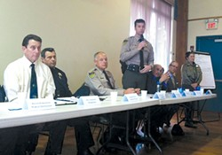 PHOTO BY GRANT SCOTT-GOFORTH - Undersheriff Bill Honsal (standing) responds to a community member's question at the feb. 26 meeting.