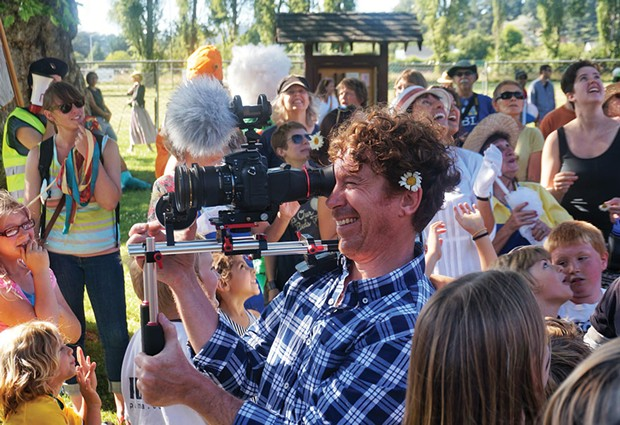 Videographer Chuck Johnson shoots a music video for new band Mad River Rose on Sunday, June 29, in Blue Lake's Perigot Park. - PHOTO BY BOB DORAN