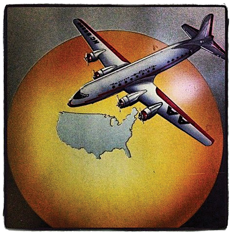 Vintage advertising art for American Airlines at the Silver Lining Restaurant. - PHOTO BY BOB DORAN
