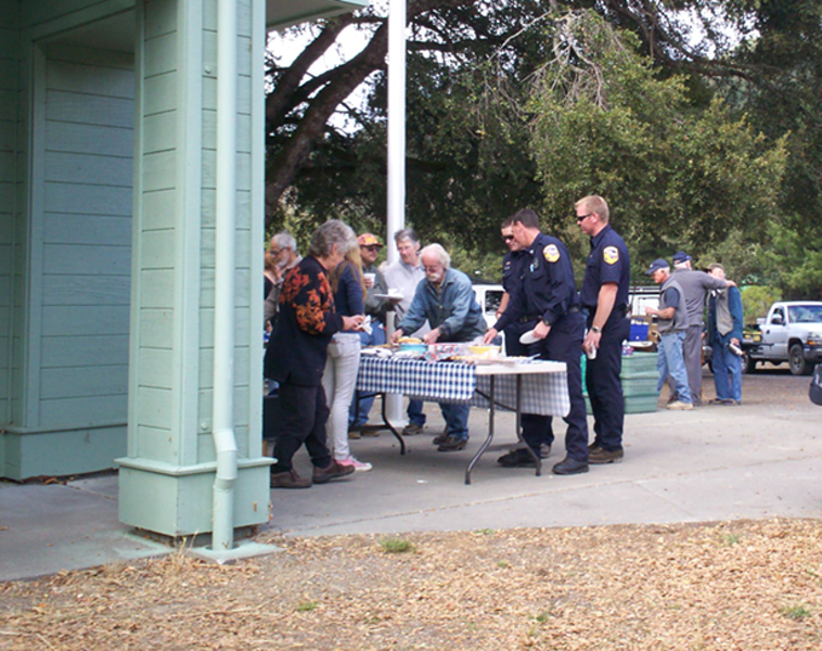 Mattole Station's CAL FIRE team checking out the dessert table at the Honeydew Elementary School Grand Slam Fundraiser - LINDA STANSBERRY