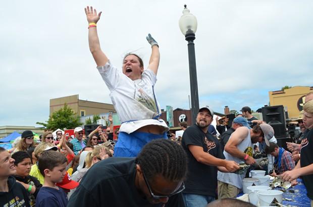 Zack Mathieu celebrates his shucking victory. - PHOTO BY GRANT SCOTT-GOFORTH