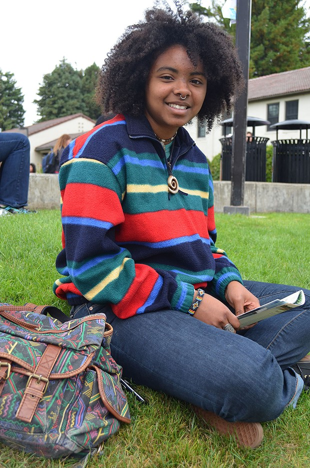 Zendrea, a freshman in zoology, hails from Santa Cruz and loves the open spaces and redwood trees up here. She's pairing her bright sweater from the Bargain Barn with a quartz necklace she got as a gift. - PHOTO BY SHARON RUCHTE