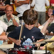 Beat the drum slowly ...