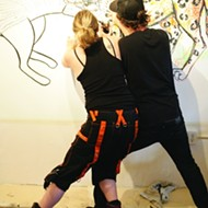Pairs of artists participate in Collaborate Combative Drawing at the Steynberg Gallery
