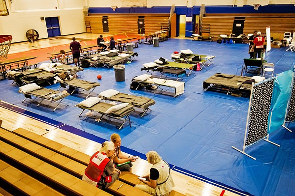 GIMME SHELTER? Fire officials say they're following health guidelines to keep COVID-19 out of evacuation centers during wildfires. Flamson Middle School in Paso Robles (pictured) served as a shelter for evacuees of the Chimney Fire in 2016. - FILE PHOTO BY JAYSON MELLOM
