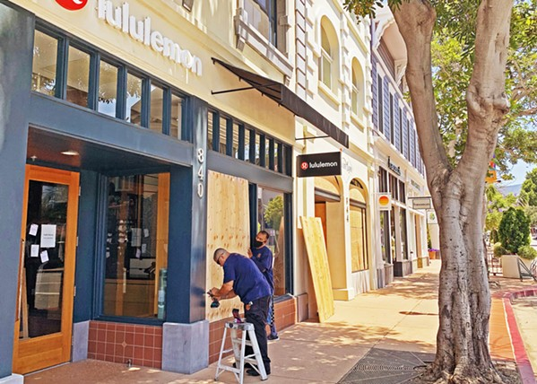 BOTH SIDES Discussions between business owners and protesters following downtown stores boarding up in anticipation of protests back in June has continued to overshadow conversations about racial injustice. - FILE PHOTO BY CAMILLIA LANHAM