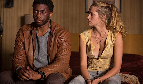 ALL HAIL THE KING While searching for his missing sister in LA, South African Jacob King (Chadwick Boseman) meets Kelly (Teresa Palmer), a down-on-her-luck single mom who helps him as much as he helps her, in Message from the King, currently screening on Netflix. - PHOTO COURTESY OF BACKUP MEDIA