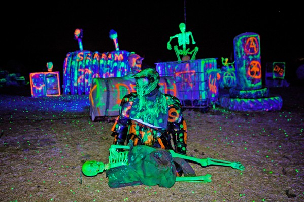 """THE LIVING DEAD A """"zombie"""" is poised on the field at Gladiator Paintball Park's Zombie Hunt on Oct. 3. Zombies will be available for hunting every weekend in October. - PHOTO BY JAYSON MELLOM"""