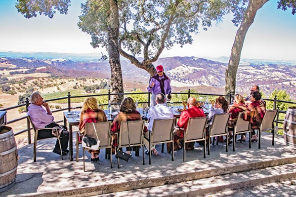 PANDEMIC SEATING Taste with a view at Adelaida Vineyards in a space normally reserved for events, on the hilltop under the canopy of 100-year-old oak trees. - PHOTO COURTESY OF ADELAIDA VINEYARDS AND WINERY