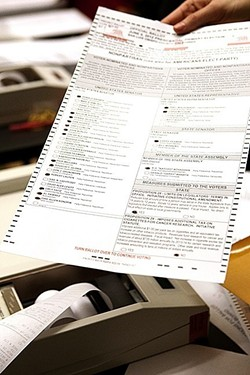 SIGNING BALLOTS While some voters are already receiving alerts that their ballots have signature match problems, the SLO County clerk-recorder said not to worry yet. - FILE PHOTO