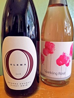 GLOBAL SHIPMENT The 2018 pinot noir from Olema in Sonoma County and the 2018 Huber sparkling rose from Austria were just two of the 12 bottles included in October's SLO Wine and Beer Co. wine club shipment. - PHOTO BY ANDREA ROOKS