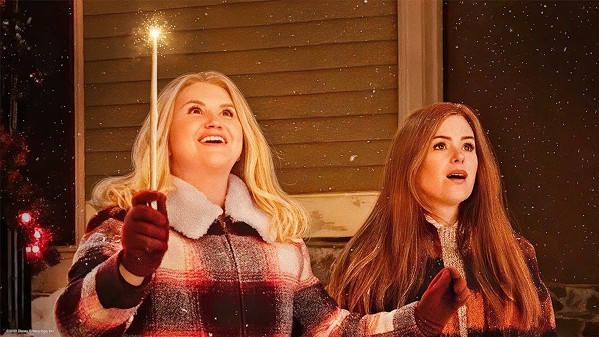 BE CAREFUL WHAT YOU WISH FOR Fairy-godmother-in-training Eleanor Fay Bloomingbottom (Jillian Bell, left) takes on her first assignment, Mackenzie Walsh (Isla Fisher, right), in Disney's Godmothered (2020). - PHOTO COURTESY OF DISNEY