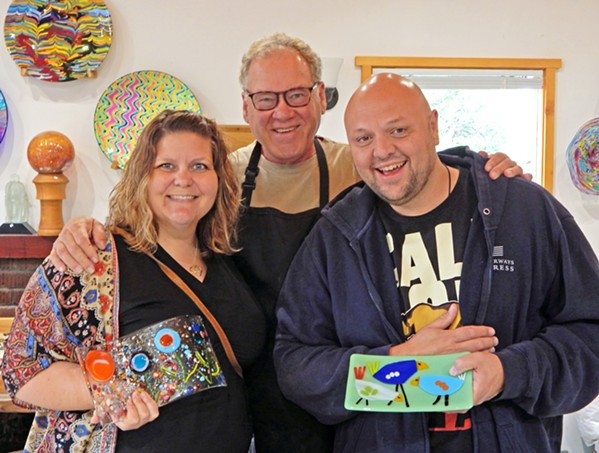ART MENTOR Marie Bolin (left) and Charles Bolin (right) show off their glass work after a September 2019 Veterans Voices fused glass workshop led by Larry Le Brane (center). - COURTESY PHOTO BY CARLOTA SANTA CRUZ