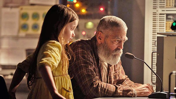 FINAL ACT Terminally ill scientist Dr. Augustine Lofthouse (George Clooney, who also directs), works to contact a spacecraft returning to a doomed Earth while caring for Iris (Caoilinn Springall), a little girl left behind from an evacuation, in The Midnight Sky, streaming on Netflix. - PHOTO COURTESY OF ANONYMOUS CONTENT