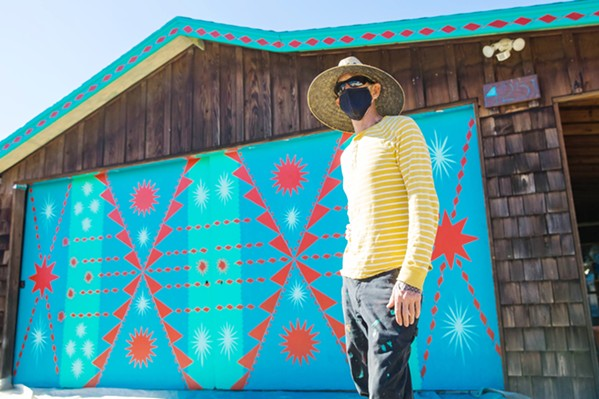 ONE OF A KIND The Edna Valley Design Ranch is already filled with art and custom design, but to spruce up the game room garage door, owner Alaina McBride hired world-famous muralist, Shrine, to free-hand this impromptu design. - PHOTO BY JAYSON MELLOM