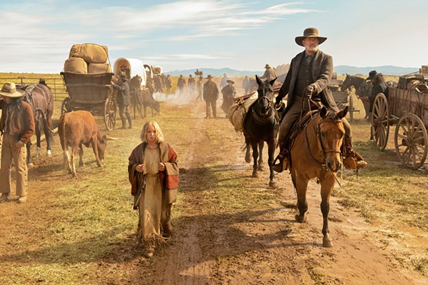 ON THE ROAD Kidnaped by the Kiowa as a small child, Johanna (Helena Zengel) is being escorted home to the white family she doesn't remember by Civil War veteran Capt. Jefferson Kyle Kidd (Tom Hanks), in the episodic Western News of the World, screening on demand. - PHOTO COURTESY OF UNIVERSAL PICTURES