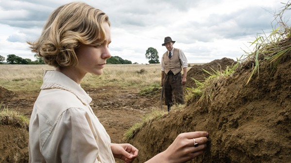 PARTNERS Suffolk landowner Edith Pretty (Carey Mulligan) hires self-described excavator Basil Brown (Ralph Fiennes) for an archaeological dig of what appears to be burial mounds on her property, leading to a remarkable discovery, in Netflix's The Dig, based on real events. - PHOTO COURTESY OF MAGNOLIA MAE FILMS