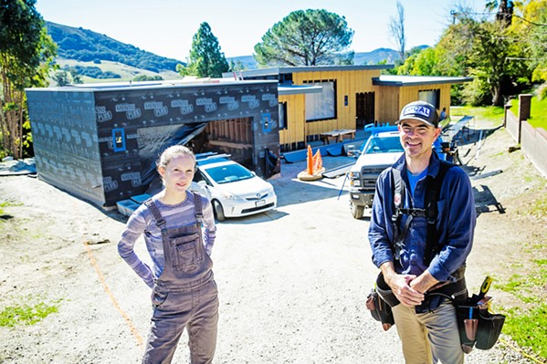 WITH EFFICIENCY IN MIND Michael Horgan (right) and Hannah McKay (left) collaborate to build the first passive house in San Luis Obispo. - PHOTO BY JAYSON MELLOM