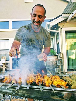 GRILL MAN Sina Shakerian and his wife, Lindsey Shakerian, started Shekamoo Grill in 2020 as a pop-up restaurant to share Persian food with North SLO County. - PHOTOS COURTESY OF SINA SHAKERIAN