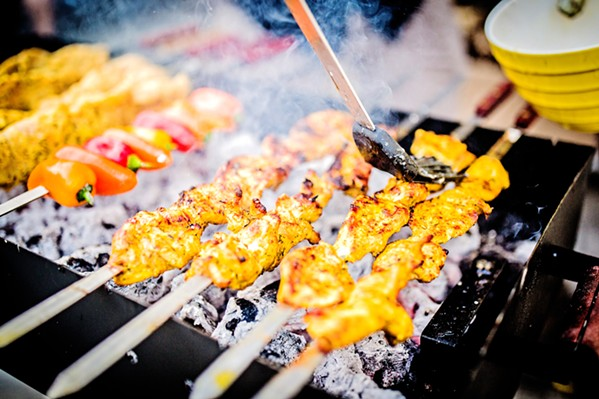 HEAT'S ON Traditionally grilled over charcoal, the chicken kabob is marinated in lime juice, yogurt, saffron, and onions for a couple of days before it meets the heat. - PHOTOS COURTESY OF SINA SHAKERIAN