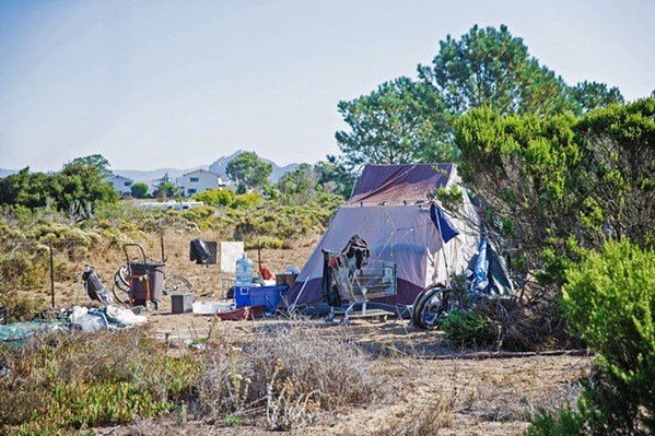 OFF THE GRID Those living in homeless camps across SLO County sometimes don't have the documentation needed to get their economic impact payments. - FILE PHOTO BY JAYSON MELLOM