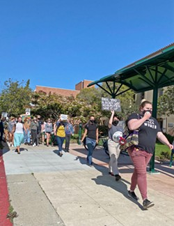CONTINUED SUPPORT About 40 people gathered in front of the Palm street entrance of the SLO County Courthouse in protest of the SLO County District Attorney's Office's recent motion to file a gag order against Tianna Arata and four other protesters. - PHOTO BY KAREN GARCIA