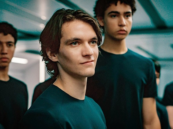 MADNESS Zac (Fionn Whitehead, center), one of 30 crew members on an 86-year-long space voyage, goes power mad, splitting the crew into warring tribes, in Voyagers, screening at Galaxy and Park. - PHOTO COURTESY OF AGC STUDIOS AND FIBONACCI FILMS