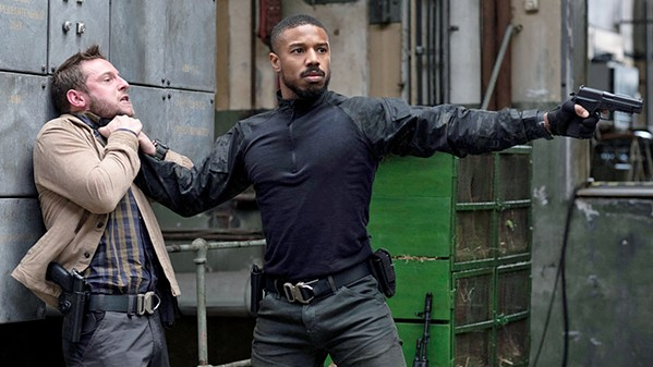 MAN ON FIRE Navy SEAL John Clark (Michael B. Jordan, right) chokes CIA operative Robert Ritter (Jamie Bell) in Tom Clancy's Without Remorse, a new straight-to-streaming film on Amazon Prime. - PHOTO COURTESY OF NEW REPUBLIC PICTURES