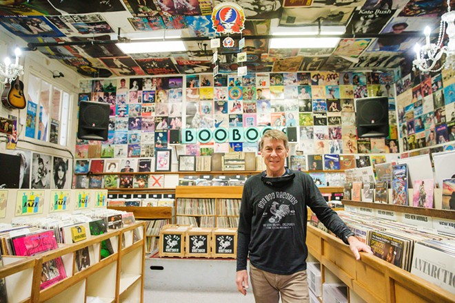 TUNES, TUNES, TUNES Boo Boo Records owner Mike White stands in the back of his shop, the Best Place to Buy Music for several years running. - PHOTO BY JAYSON MELLOM