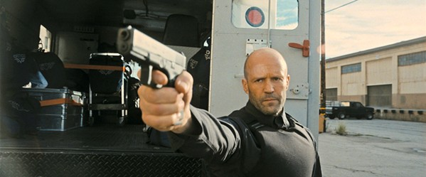 MYSTERY MAN In Guy Ritchie's Wrath of Man, H (Jason Statham) takes a job with an armored truck company that transports cash, but it's all a ruse to find the thieves who murdered his son in an armed robbery. - PHOTO COURTESY OF METRO-GOLDWYN-MAYER