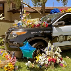 IN THE LINE OF DUTY Community members are leaving balloons and flowers outside the San Luis Obispo Police Department to memorialize SLO Police Detective Luca Benedetti. - PHOTO COURTESY OF SLOPD FACEBOOK