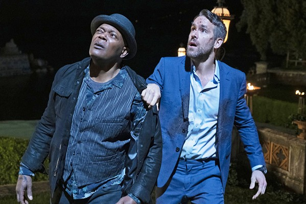 THEY'RE BACK! Hitman Darius Kincaid (Samuel L. Jackson, left) and bodyguard Michael Bryce (Ryan Reynolds) are back for another violent misadventure in the sequel The Hitman's Wife's Bodyguard, now in theaters. - PHOTO COURTESY OF MILLENNIUM MEDIA AND SUMMIT ENTERTAINMENT