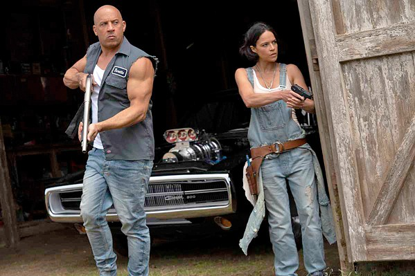 CALL FIRST NEXT TIME Dom (Vin Diesel) and Letty (Michelle Rodriguez) react to unexpected visitors at their secluded home, in F9: The Fast Saga, now screening at local theaters. - PHOTO COURTESY OF ONE RACE FILMS
