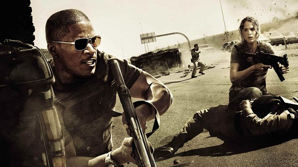 STRANGERS IN A STRANGE LAND American FBI Agents Ronald Fleury (Jamie Foxx) and Janet Mayes (Jennifer Garner) race against time to find a terrorist cell responsible for an attack on a U.S. military base in Saudi Arabia, in The Kingdom, screening on HBO Max. - PHOTO COURTESY OF UNIVERSAL PICTURES