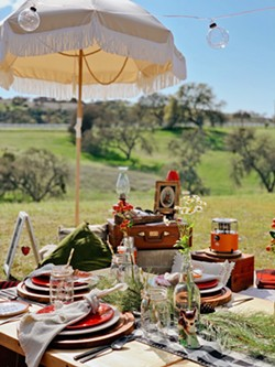 """INTO THE FOREST Wildernest Picnic Co. sets up its glamping-themed """"Babes in the Woods"""" picnic spread in March at a private property in Templeton. The owners wanted to commemorate the future site of their home. - PHOTO COURTESY OF WILDERNEST PICNIC CO."""