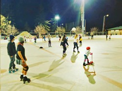 GROUP SKATE SLORoll hosts monthly community skate nights, like this one recently at Santa Rosa Park in San Luis Obispo. The skates include a DJ, party lights, and are open to skaters of all ages and wheels. - PHOTO COURTESY OF SLOROLL COMMUNITY INITIATIVE